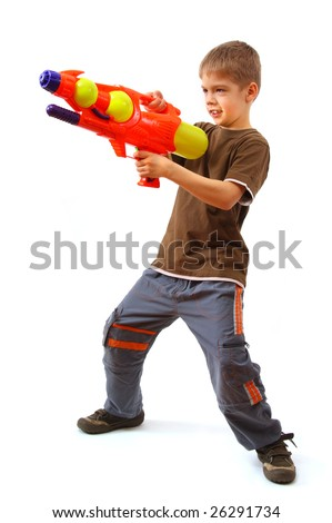 Young boy with water gun over white background. - stock photo