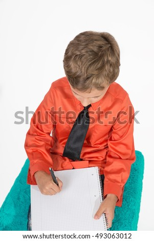 young boy write something