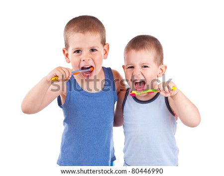 Young boys brushing his teeth with toothbrush, isolated in white
