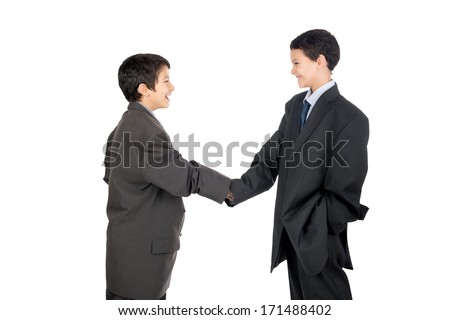 Young boys dressed with a big man's suit shaking hands