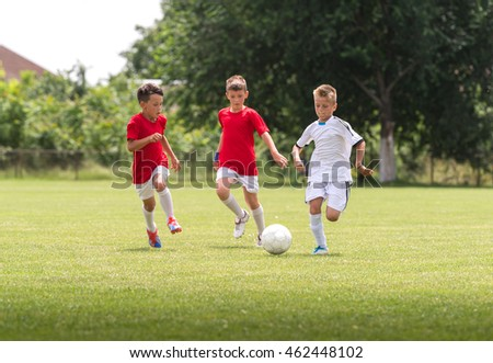 Young boys on the football training on the court