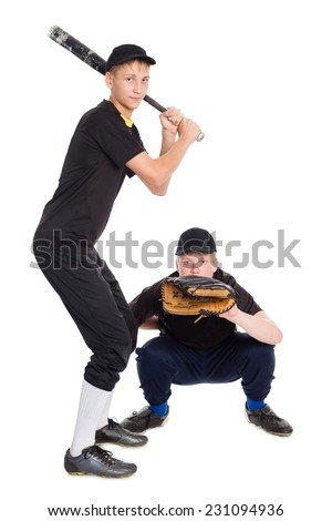Young boys play baseball. Two of the boys twin brothers. - stock photo