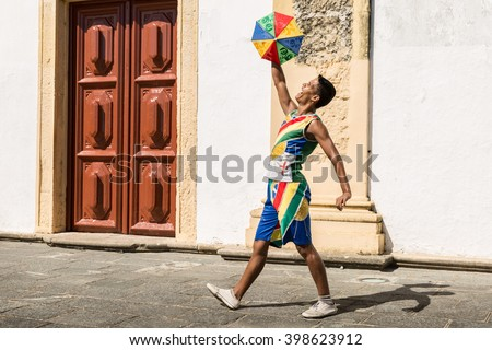 Young Brazilian man dancing Frevo in Olinda, Brazil