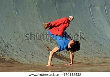 Young breakdance on the street - stock photo