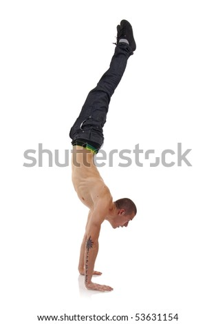 young breakdancer in move against grey background - hand stand - stock photo