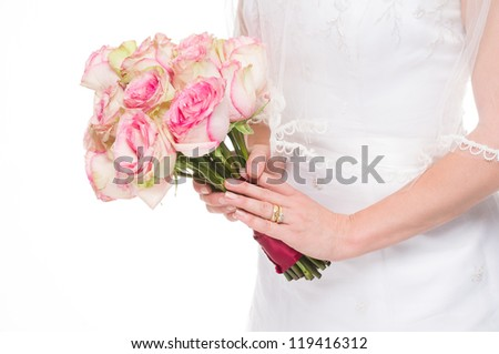 Young bride holding a bouquet on isolated white background with gold wedding ring.