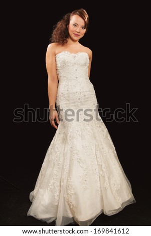 young bride in the studio black backround - stock photo