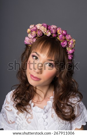 young bride looks into camera. beautiful makeup and jewelry in pink - stock photo