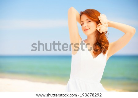 Young bride on the beach - stock photo