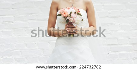 Young bride on wedding day against wall break wall.  - stock photo