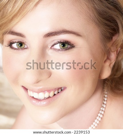 Young bride with large green eyes and short hair looking into the camera - stock photo