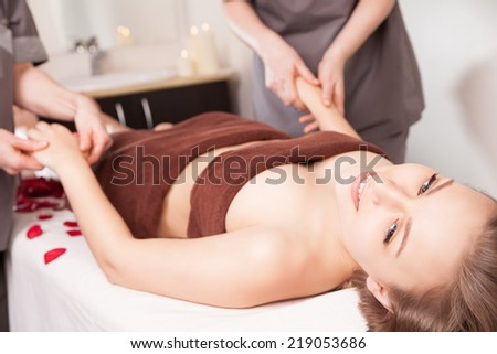 Young bright woman receiving Hands massage in the spa salon