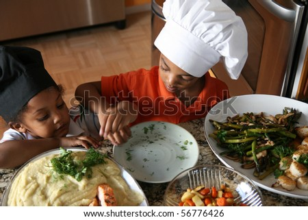 Young brothers prepaing a delicious complete meal. - stock photo