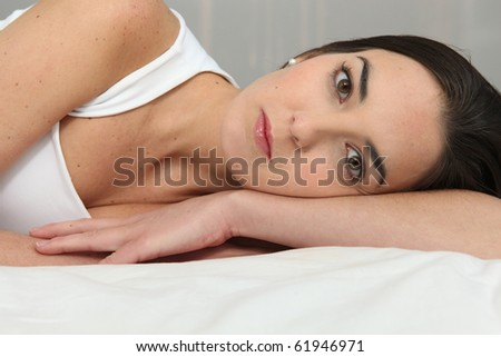 Young brown-haired woman resting