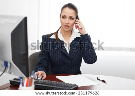 Young brunette accountant calling client in office