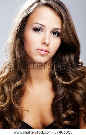 young brunette beauty  woman portrait, studio shot - stock photo