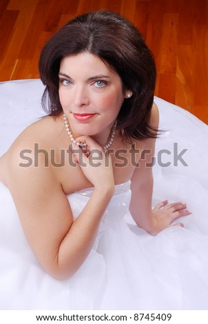 Young Brunette Bride Sat On The Floor Waiting For The Ceremony