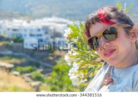 Young brunette enjoying the greek countryside in the island of Santorini, Greece during summer. - stock photo