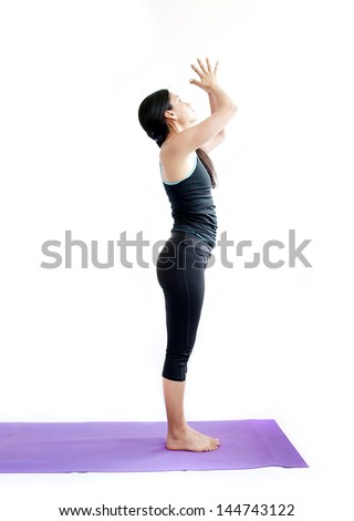 young brunette girl practising yoga isolated on white