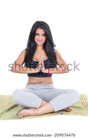 Young brunette girl sitting with crossed legs doing yoga - stock photo