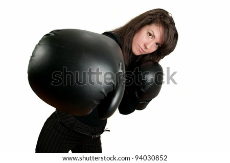 Young brunette girl with boxing gloves - stock photo
