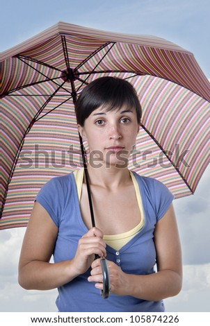 young brunette girl with umbrella in colors - stock photo
