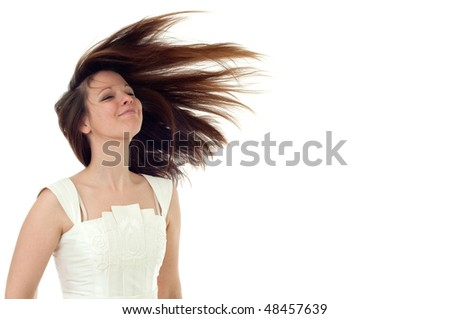 young brunette in white dress with flying hair on the white background - stock photo