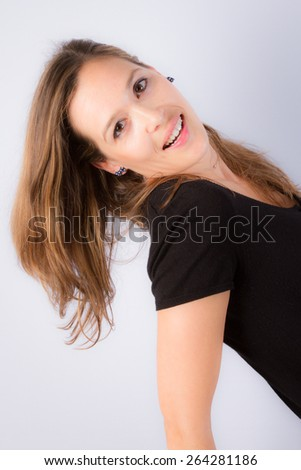 Young brunette lady in black dress - stock photo