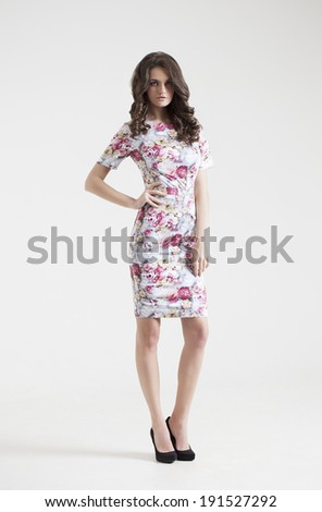 Young brunette lady in dress posing