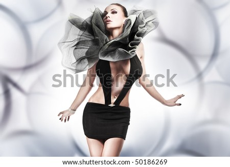 Young brunette lady posing over fantasy background - stock photo