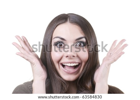 Young brunette looking excited against white background - stock photo