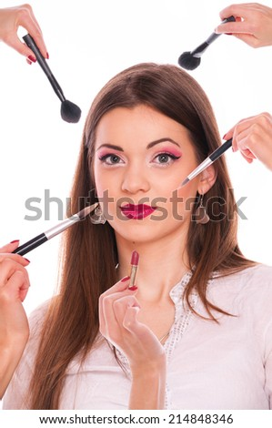 Young brunette posing for make up applying - stock photo