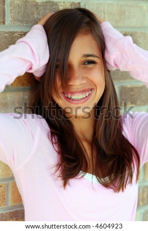 young brunette teen girl smiling with braces - stock photo