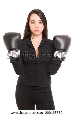 Young brunette wearing black jacket and boxing gloves. Isolated on white - stock photo