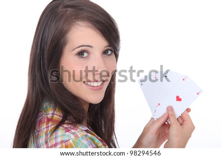 Young brunette with poker cards - stock photo