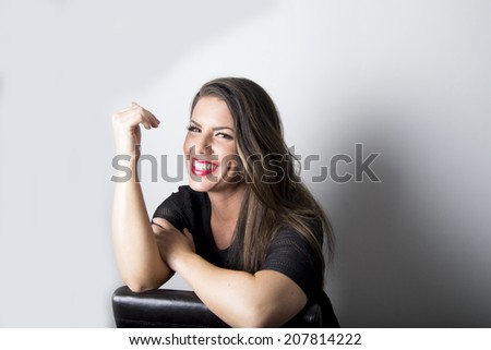 Young brunette with the prettiest smile & teeth - studio   - stock photo