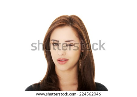 Young brunette woman blink eye - stock photo