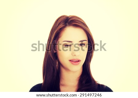 Young brunette woman blink eye