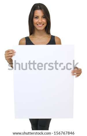 Young brunette woman holding a large white card - stock photo