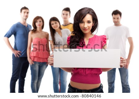 young brunette woman holding blank advertising banner - stock photo