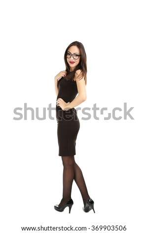 Young brunette woman in black dress on a white background - stock photo