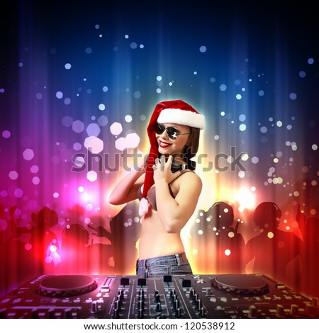 Young brunette woman in christmas wear with earphones
