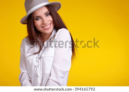 young brunette woman in spring color isolated on yellow background - stock photo