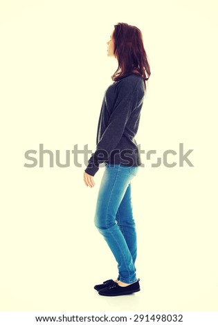 Young brunette woman looking up - stock photo