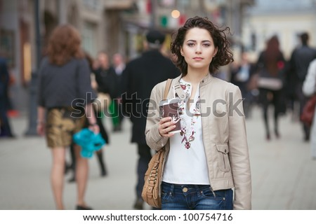 Young brunette woman outdoors - stock photo