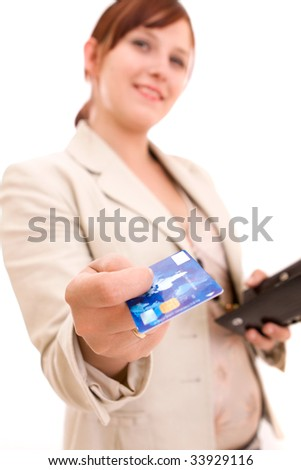 Young brunette woman paying for shopping - stock photo