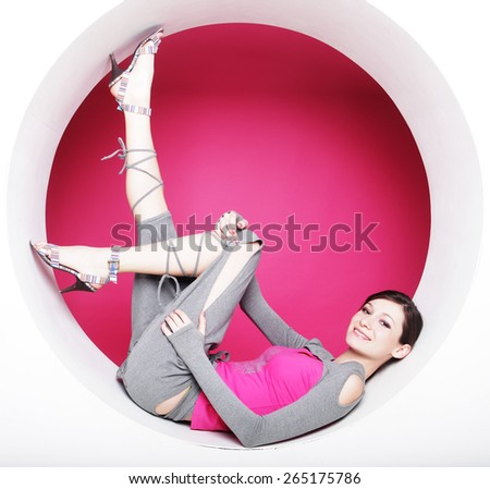 young brunette woman posing  in a circle - stock photo