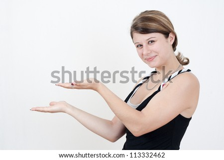 young brunette woman present something - stock photo