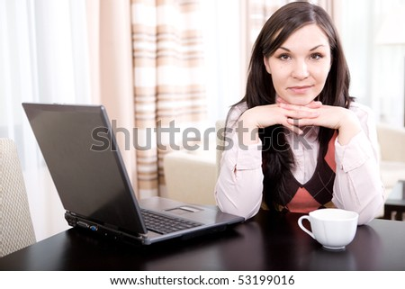 young brunette woman relaxing at home