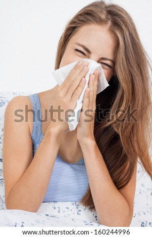 young brunette woman with flu cold influenza portrait at home - stock photo